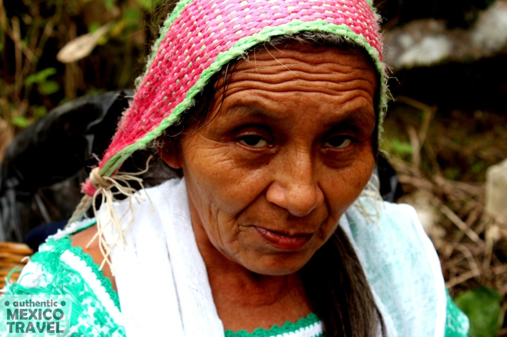 In the jungle near Jonotla a woman carries a backsling supported by a handwoven headband.